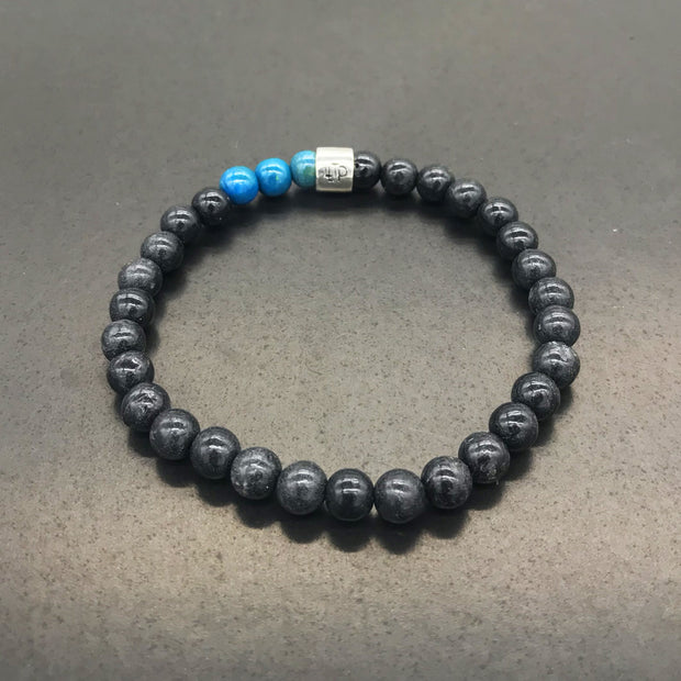 Bracelet made with BLACK recycled tennis racquet strings and 3 colored beads
