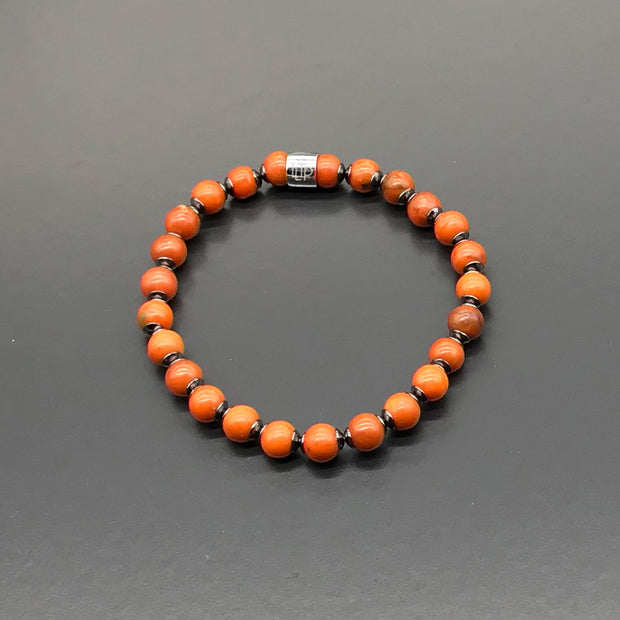 Bracelet made with recycled tennis racquet strings and bead caps