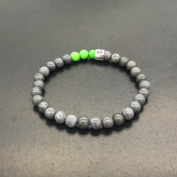 Bracelet made with GRAY recycled tennis racquet strings and 3 colored beads
