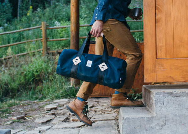 "The 22"" Duffle in navy from Topo Designs shown in use."