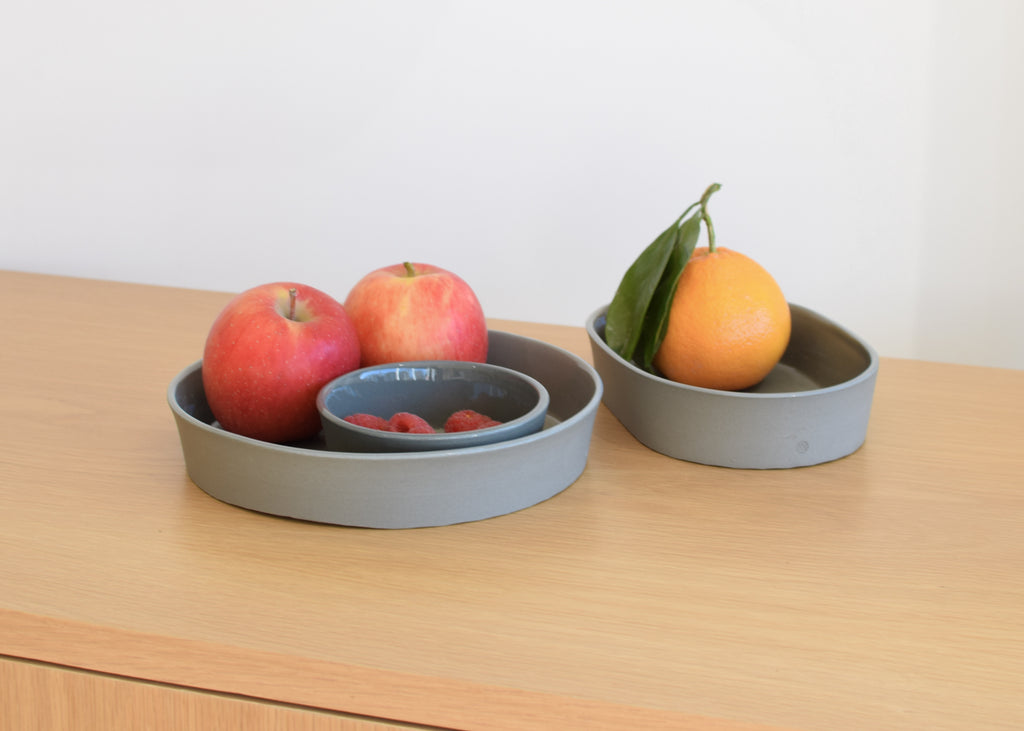 The ceramic round shaped Chroma Tray in sage by Andrew Molleur Milwaukee based Commonplace design shop.