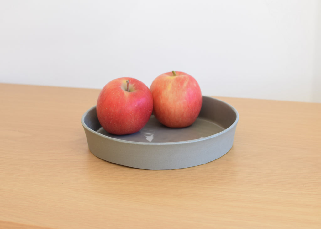 The round shaped Chroma Tray in sage by Andrew Molleur from Commonplace design shop.
