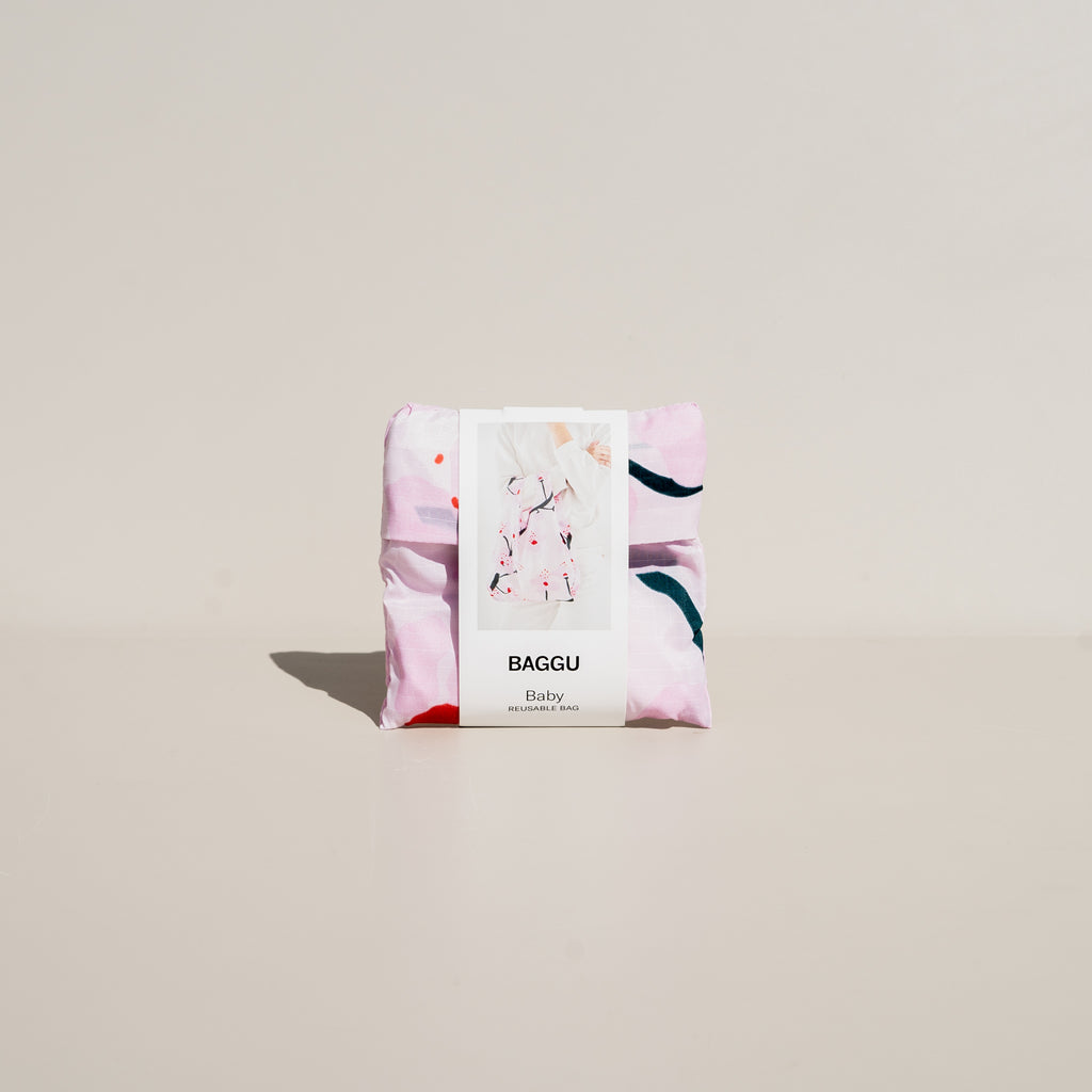 "The Baby Baggu in Cherry Blossom comes in a 4"" x 4"" pouch."