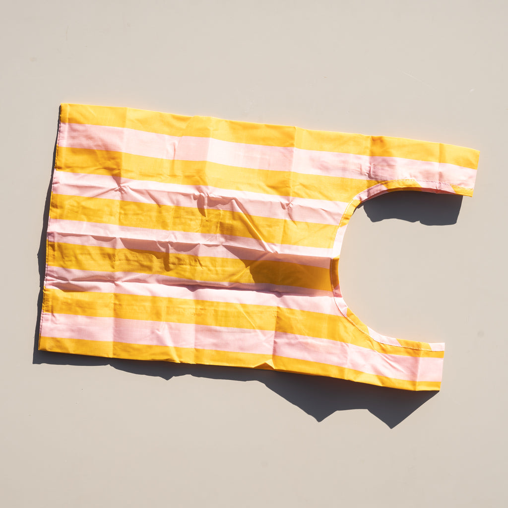 The Baby Baggu reusable tote bag in marigold stripe from Commonplace design shop in Milwaukee, Wisconsin.