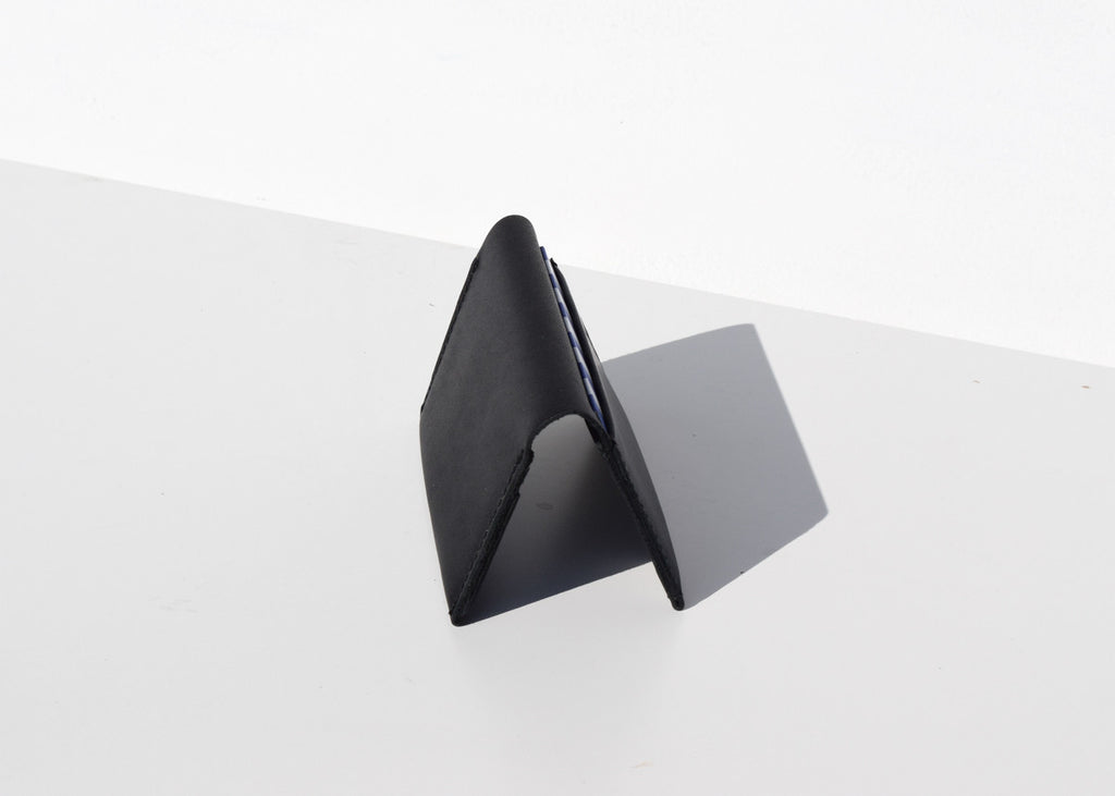 The Baggu Card Holder in black with four card slots from Commonplace.