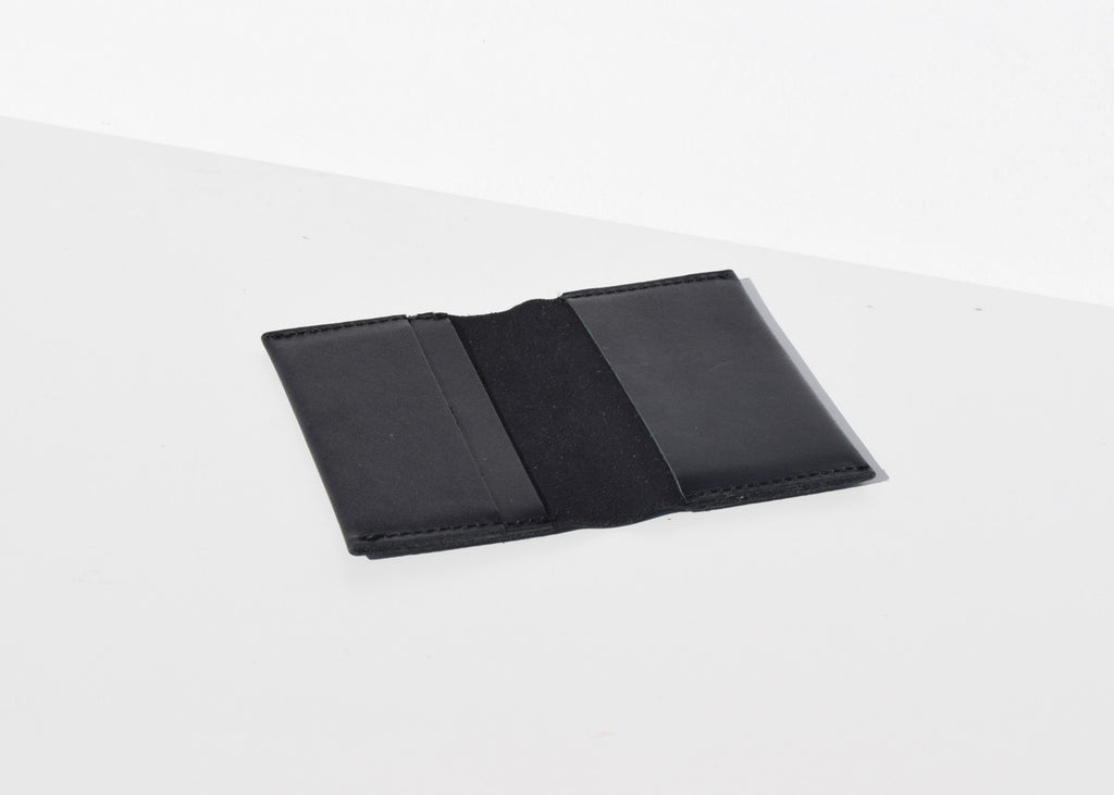 The Baggu leather Card Holder in black from Commonplace.