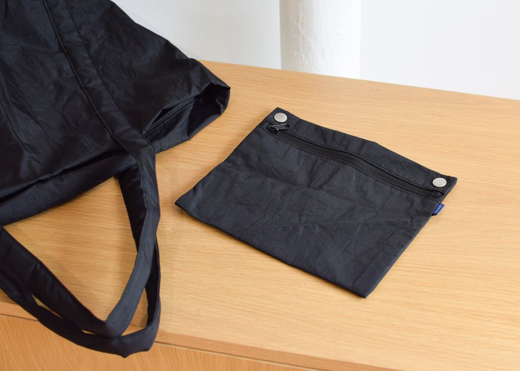 The Baggu Cloud Bag in black with detachable pouch.