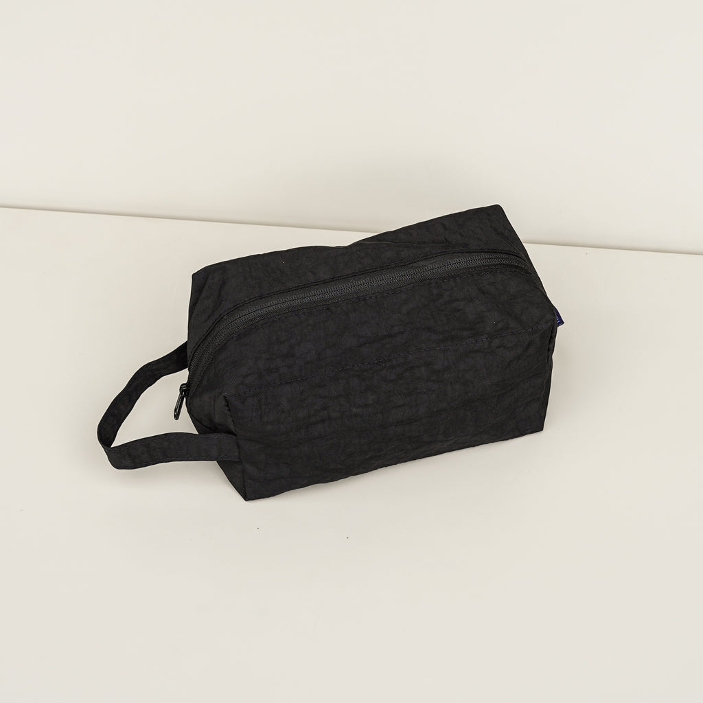 The Dopp Kit by Baggu in black color, made of heavyweight nylon.