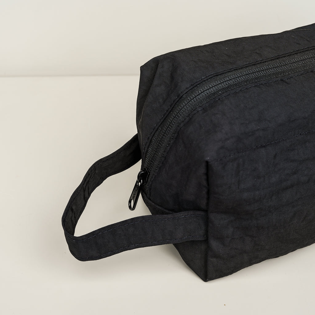 The heavyweight nylon Baggu Dopp Kit in black with handle.