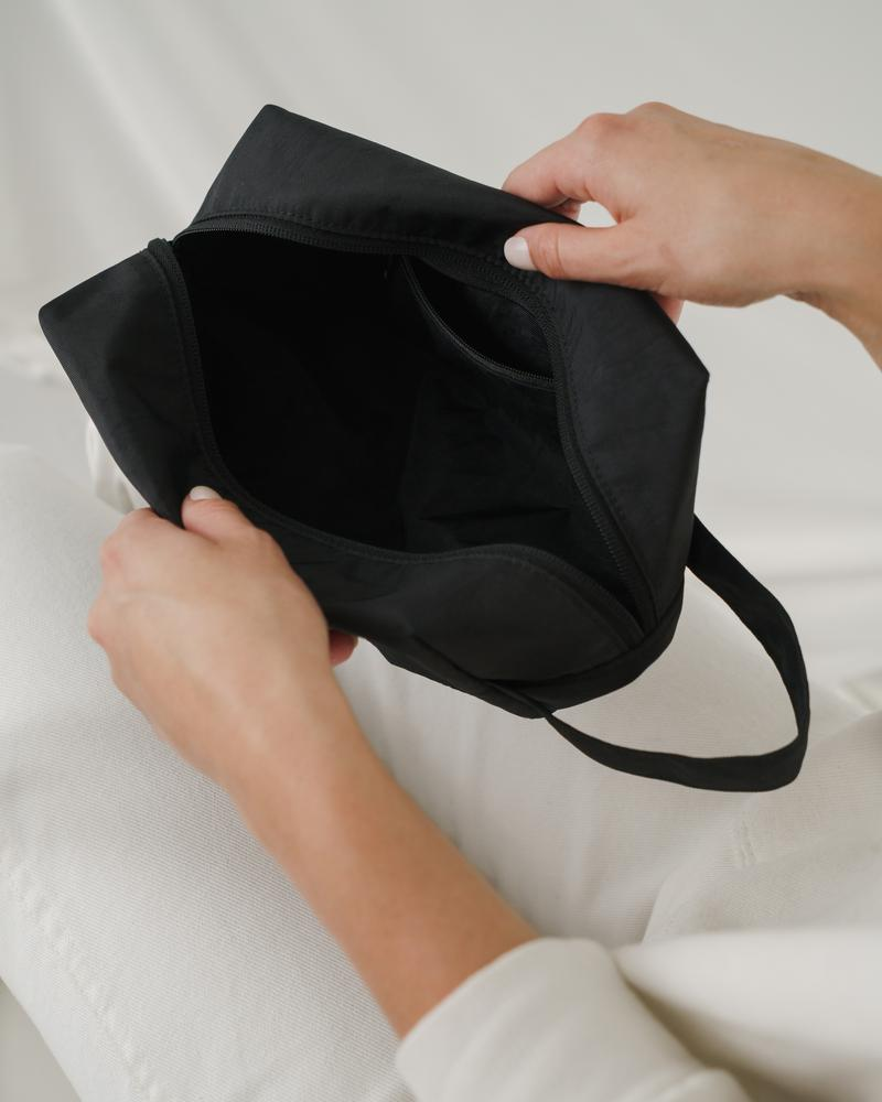 The heavyweight nylon Baggu Dopp Kit in black with interior pockets.