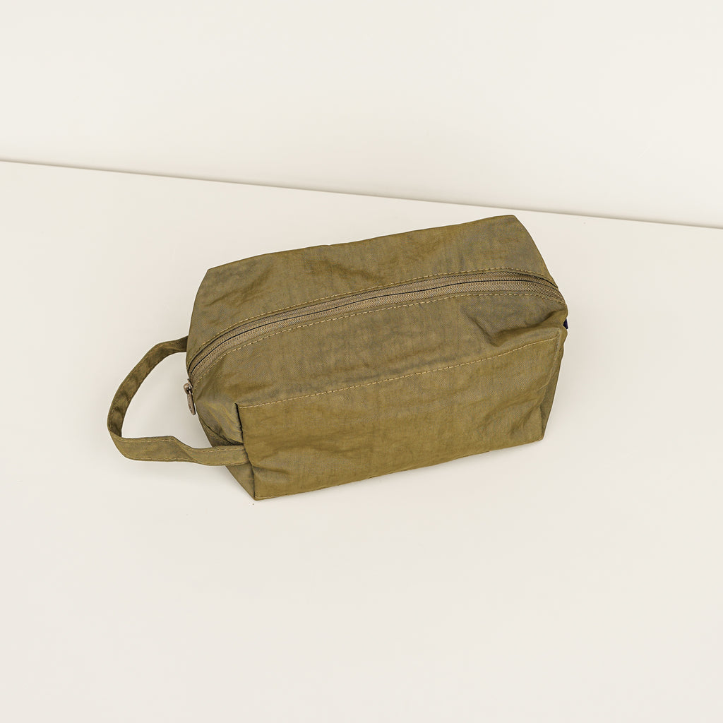 The Dopp Kit by Baggu in kelp color, made of heavyweight nylon.