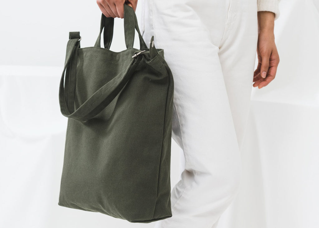 The Baggu Duck Bag in Dark Olive with two carry options from Commonplace design shop.