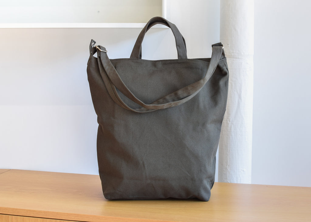 The Baggu Duck Bag in Dark Olive.