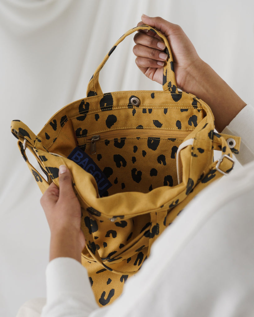 The Duck Bag in leopard on model.