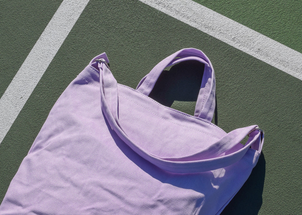 The Baggu Duck Bag in lilac, designed with a new interior zip pocket.