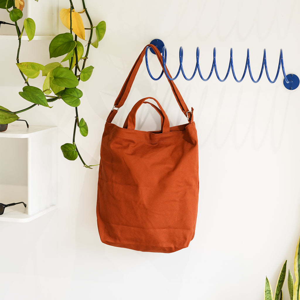 The Duck Bag in umber from Baggu on the Corkscrew Wall Hook from Commonplace design shop.