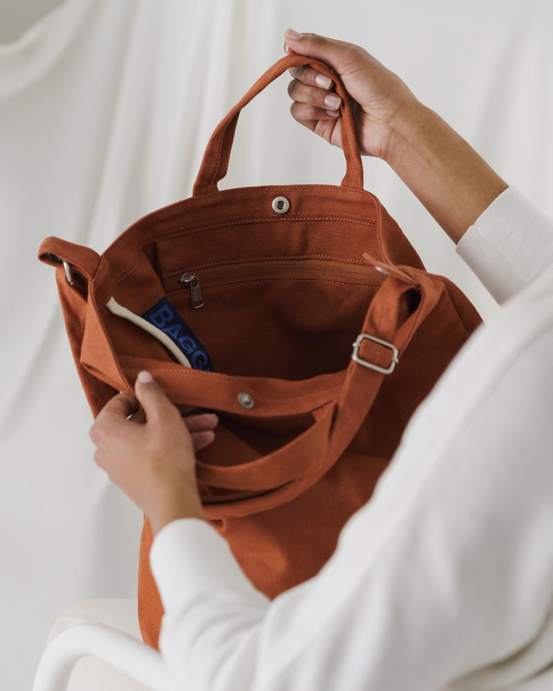 The Duck Bag in umber on model.