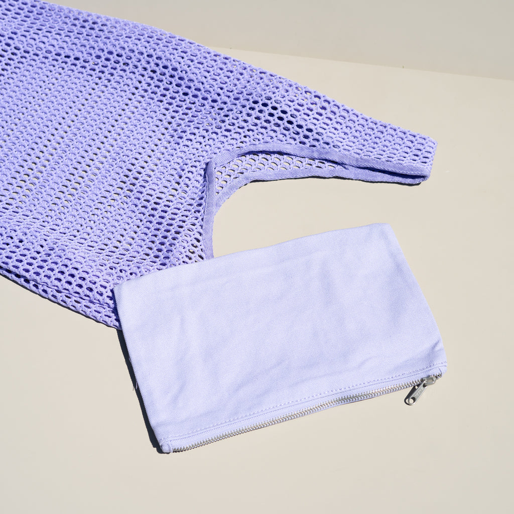 The Net Baggu tote in lilac comes with a detachable zip bag.