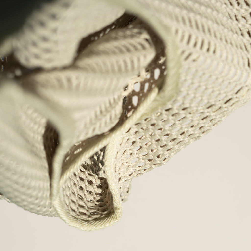 Detail shot of the Net Baggu in matcha.