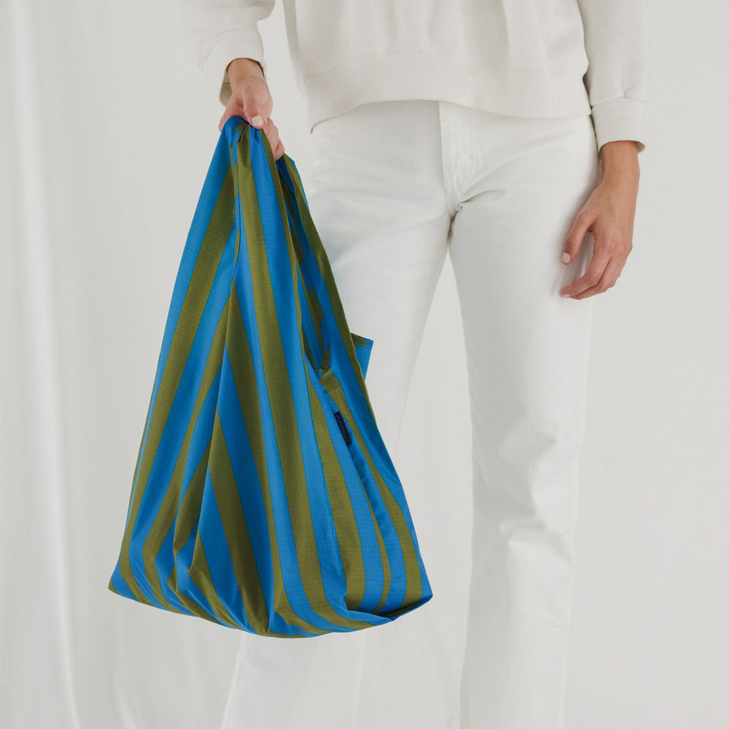 The Standard Baggu reusable tote bag in cyan stripe from bag brand Baggu.
