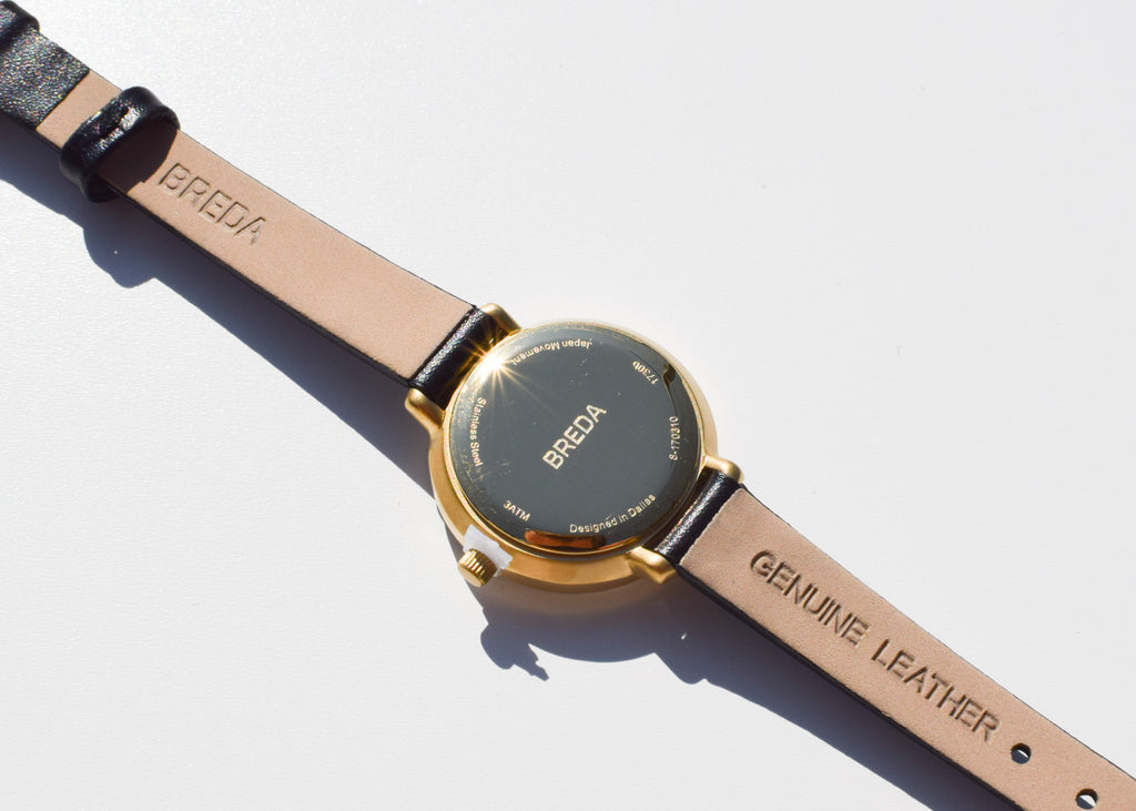 The slim 9mm Beverly Watch by Breda in gold and white from Commonplace design shop.