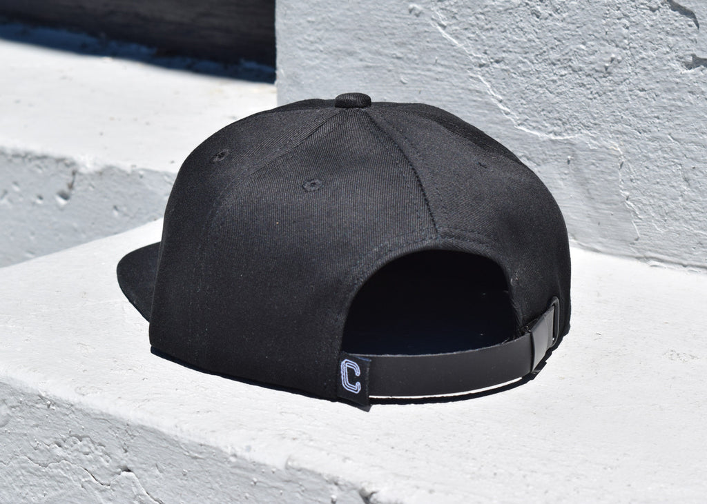 "Milwaukee Hat from Commonplace shown from the back with ""C"" logo."
