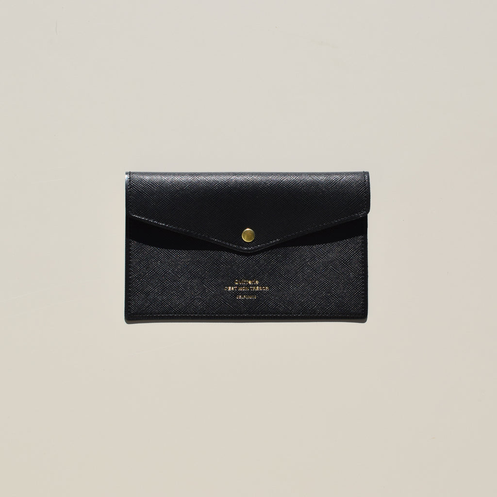 From Delfonics, Quitterie Multi-Card Case With Snap in black.