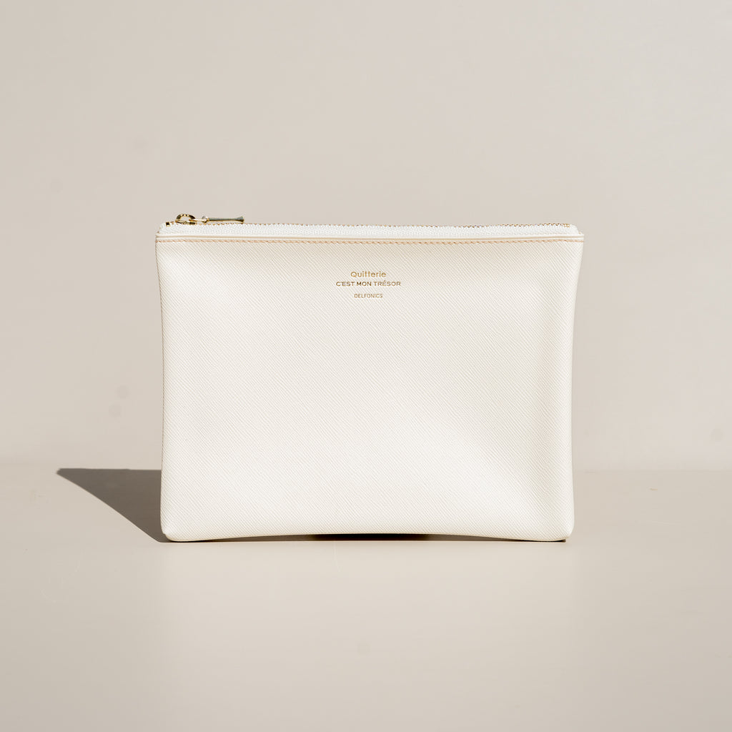 The Quitterie Pouch Case (Medium) from Delfonics in cream.