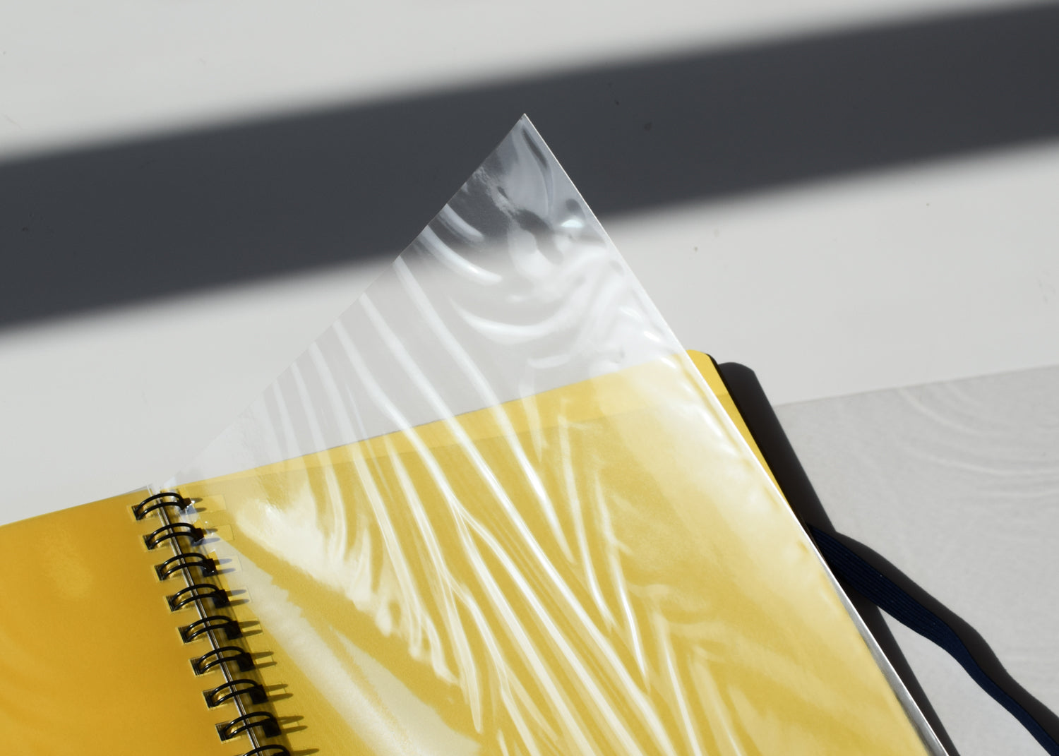 Delfonics Rollbahn Spiral Notebooks have clear document pouches.