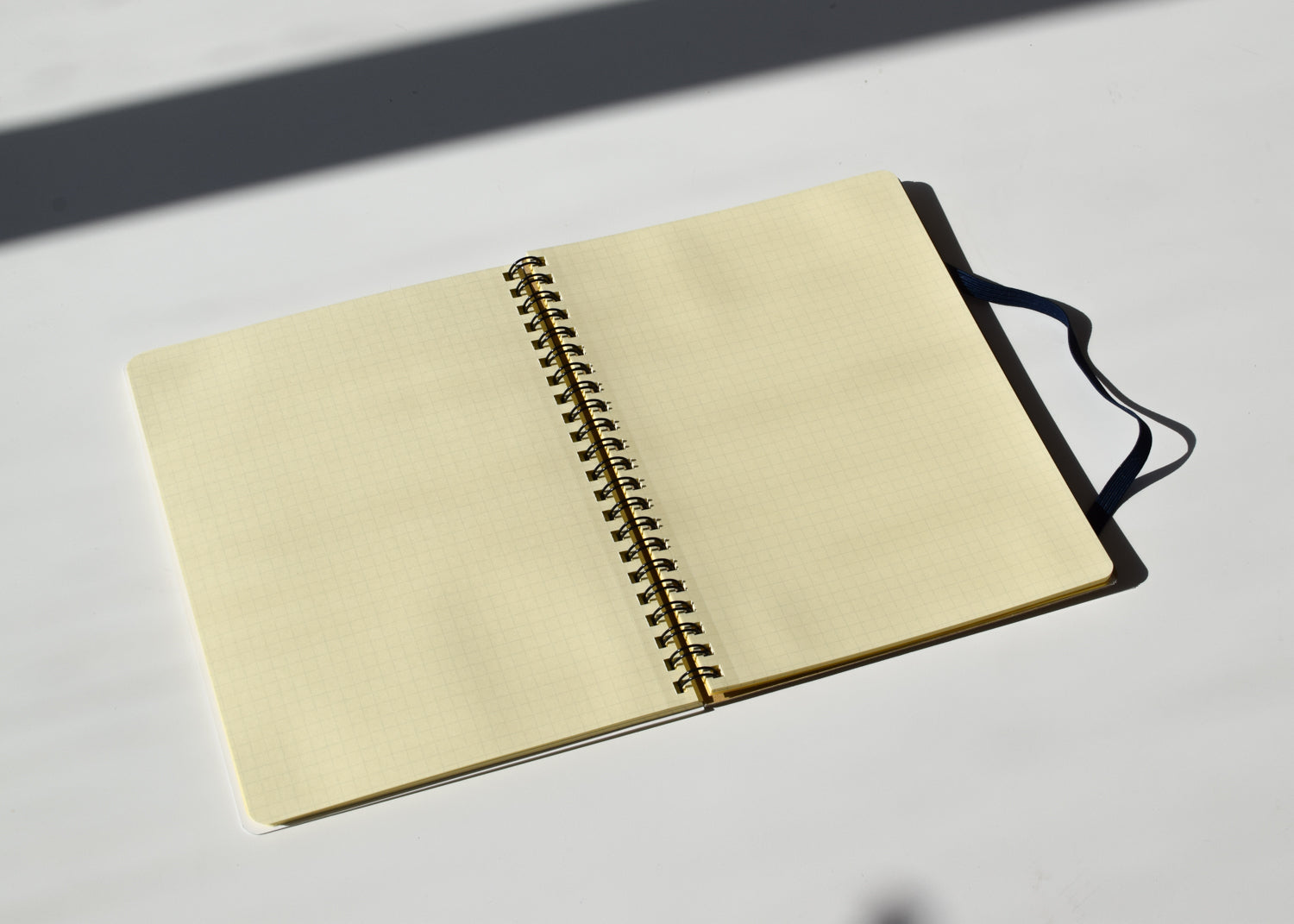 An elastic strap holds together the Rollbahn Spiral Notebook from Delfonics.