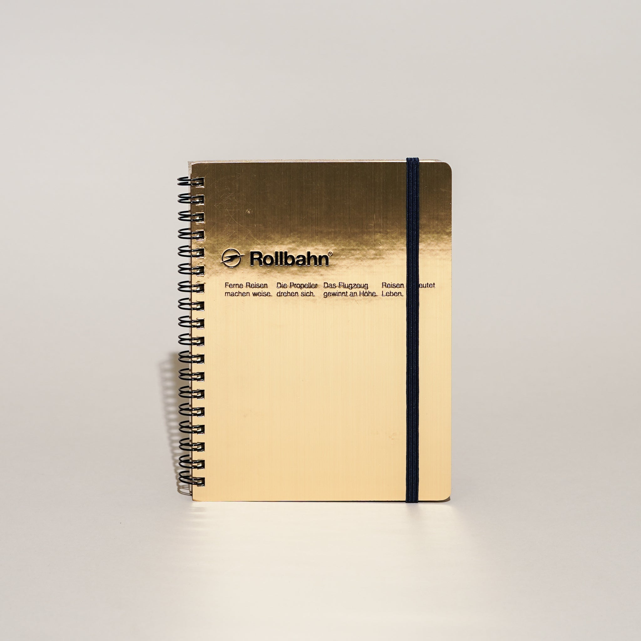 The Rollbahn Spiral Notebook Large Size from Delfonics in shiny gold.