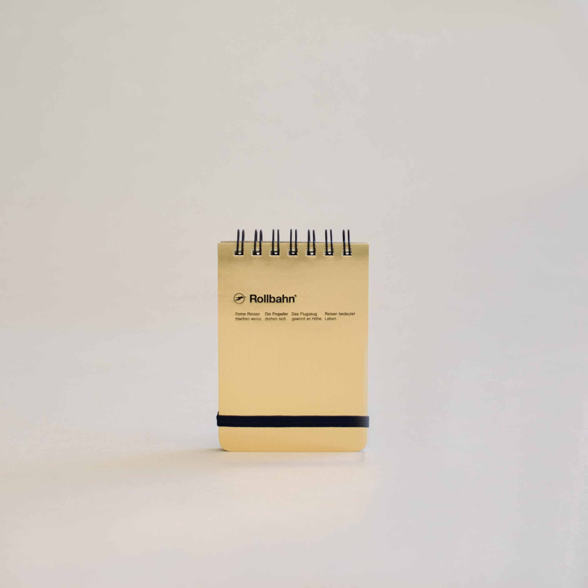 The Rollbahn Spiral Notebook Mini Flip Memo in shiny gold.
