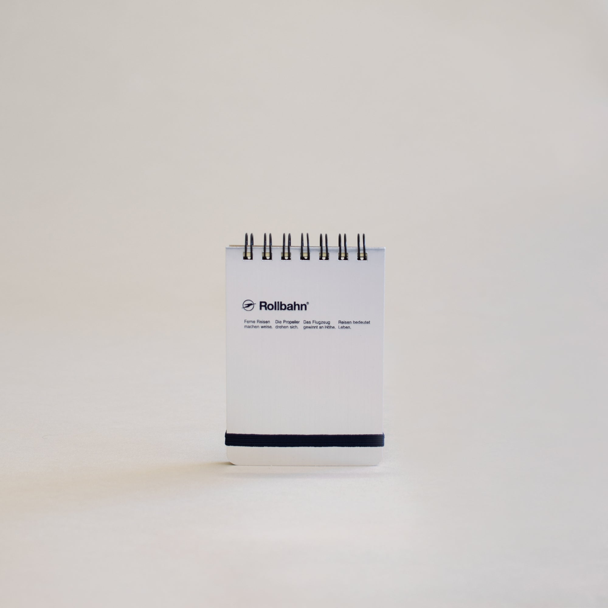The Rollbahn Spiral Notebook Mini Flip Memo from Delfonics in shiny silver.