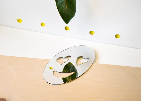 Heart Eyes Emoji Mirror designed by Miguel Ramirez from Commonplace.