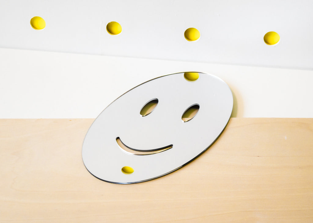 The Smile Emoji Mirror designed by Miguel Ramirez right side up.