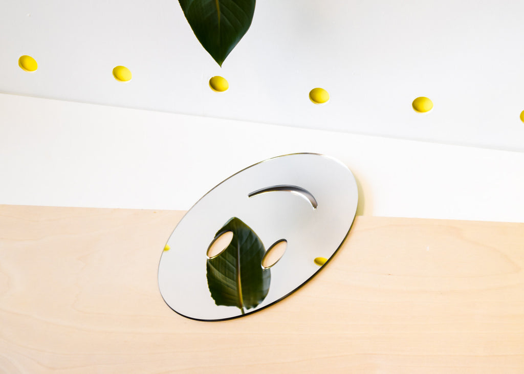 The upside-down Smile Emoji Mirror designed by Miguel Ramirez.