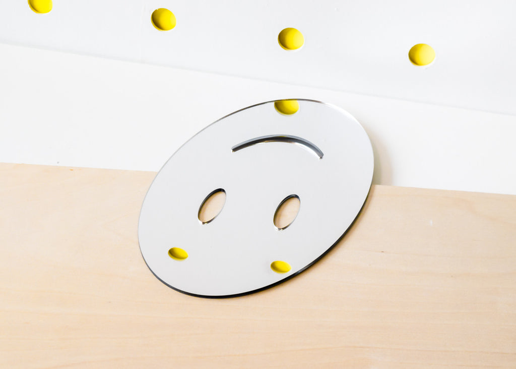 The Smile Emoji Mirror designed by Miguel Ramirez.
