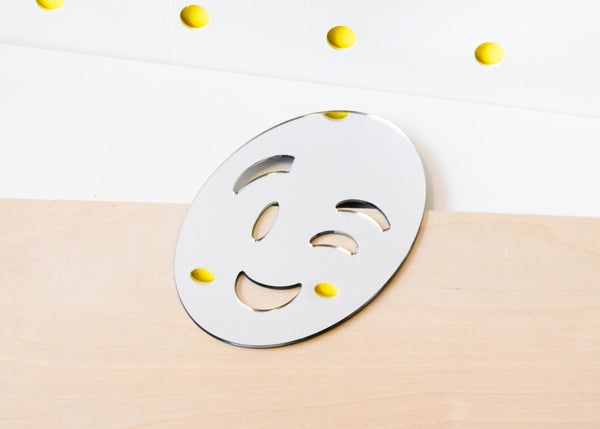 The Wink Emoji Mirror designed by Miguel Ramirez.