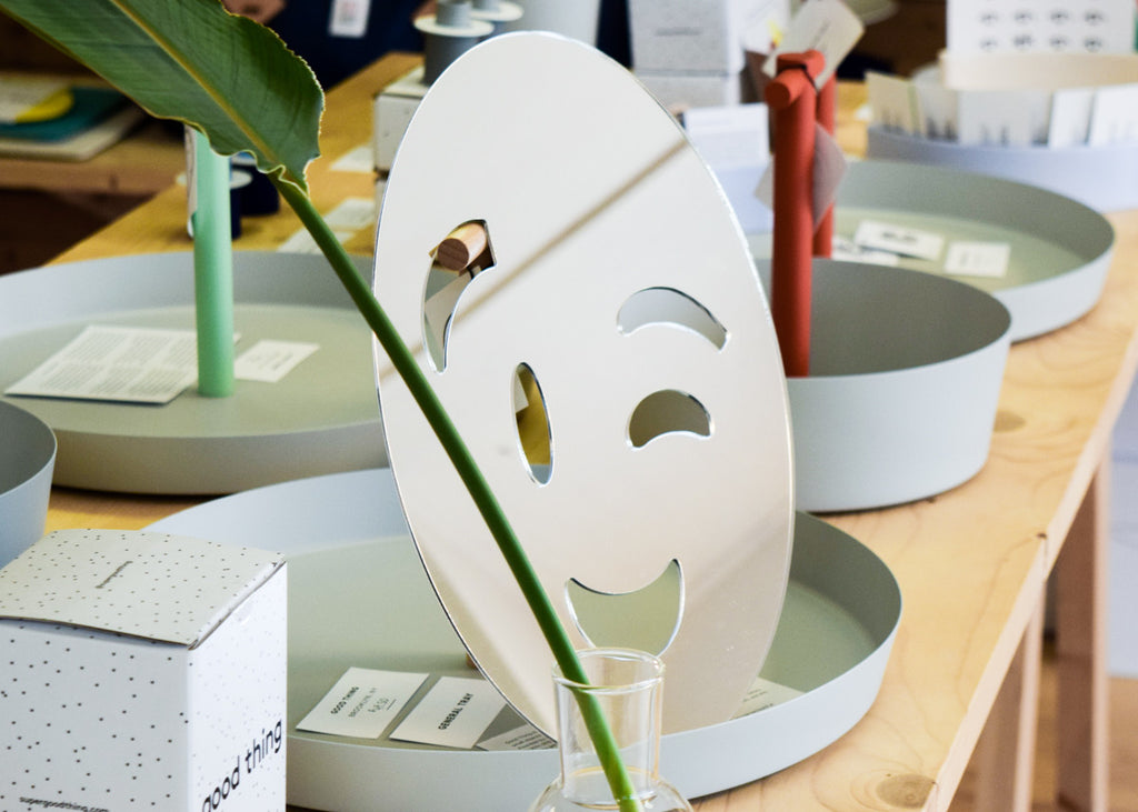 The Wink Emoji Mirror designed by Miguel Ramirez on display in Commonplace.