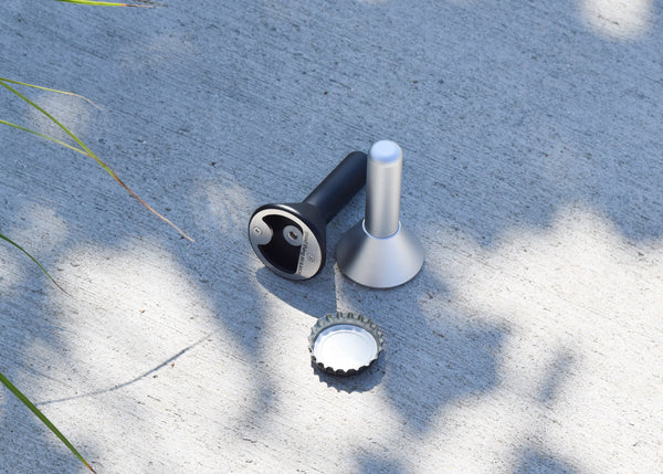 The Stand-Up Bottle Opener by Good Thing in aluminum and black.