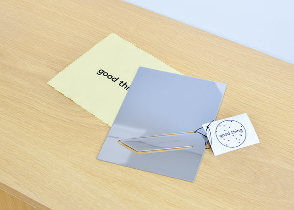 The Good Thing Easy Mirror in stainless steel ships flat with polishing cloth.