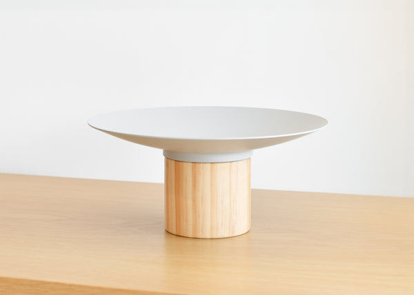 The Platform Bowl from Good Thing in gray is designed to work alone or with other bowls to create a tiered display.