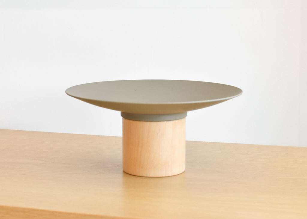 The Platform Bowl from Good Thing in green is designed to work alone or with other bowls to create a tiered display.