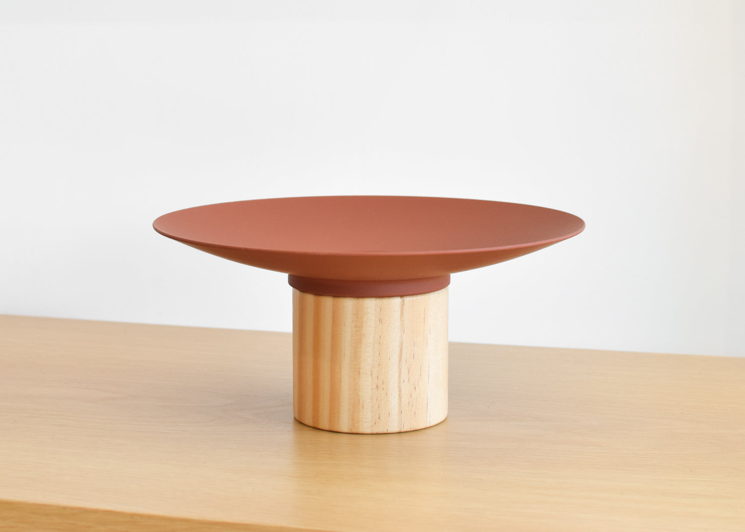 The Platform Bowl from Good Thing in red is designed to work alone or with other bowls to create a tiered display.