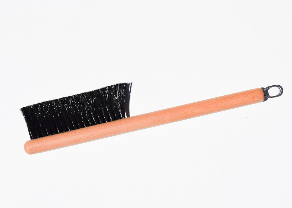 The brush of the Good Think Richman Dustpan in pink.