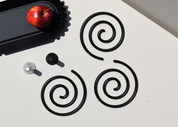 The Good Thing Spiral Trivet Set can be grouped together or separated for a series of trivets.