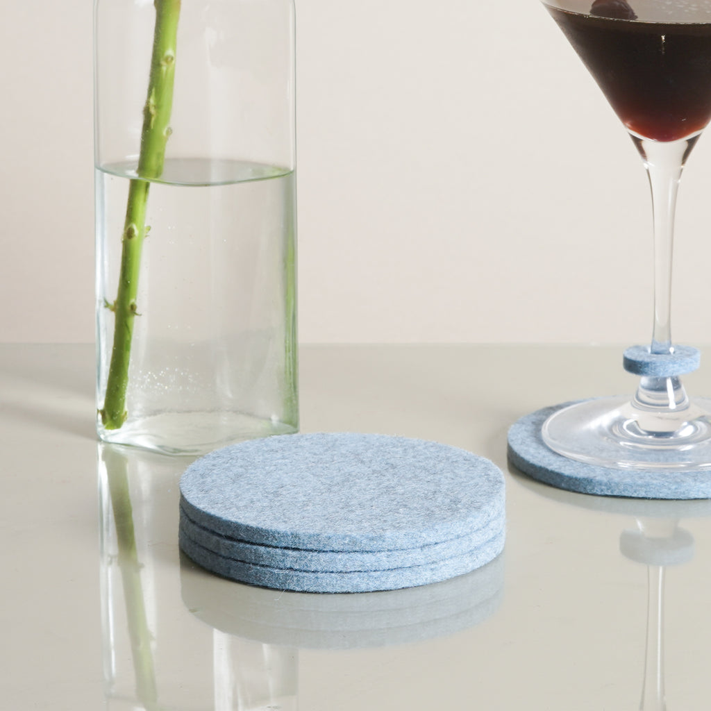 The Bierfilzl Round Felt Coasters in heather blue by Graf Lantz from Commonplace design shop.
