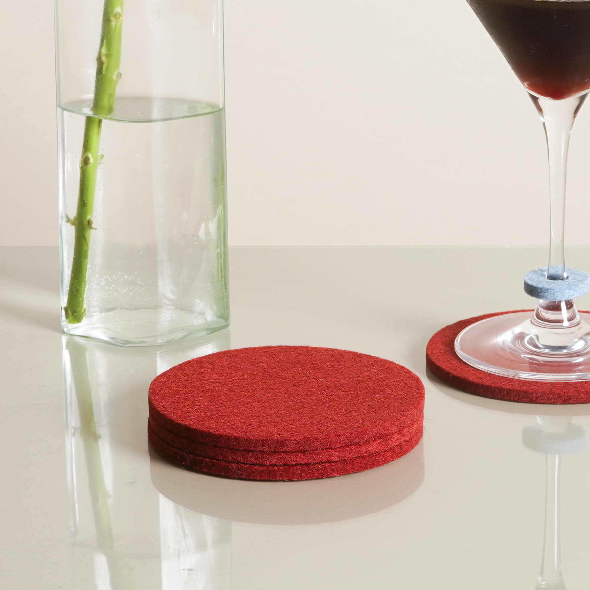 The Bierfilzl Round Felt Coasters in rosewood by Graf Lantz from Commonplace design shop.
