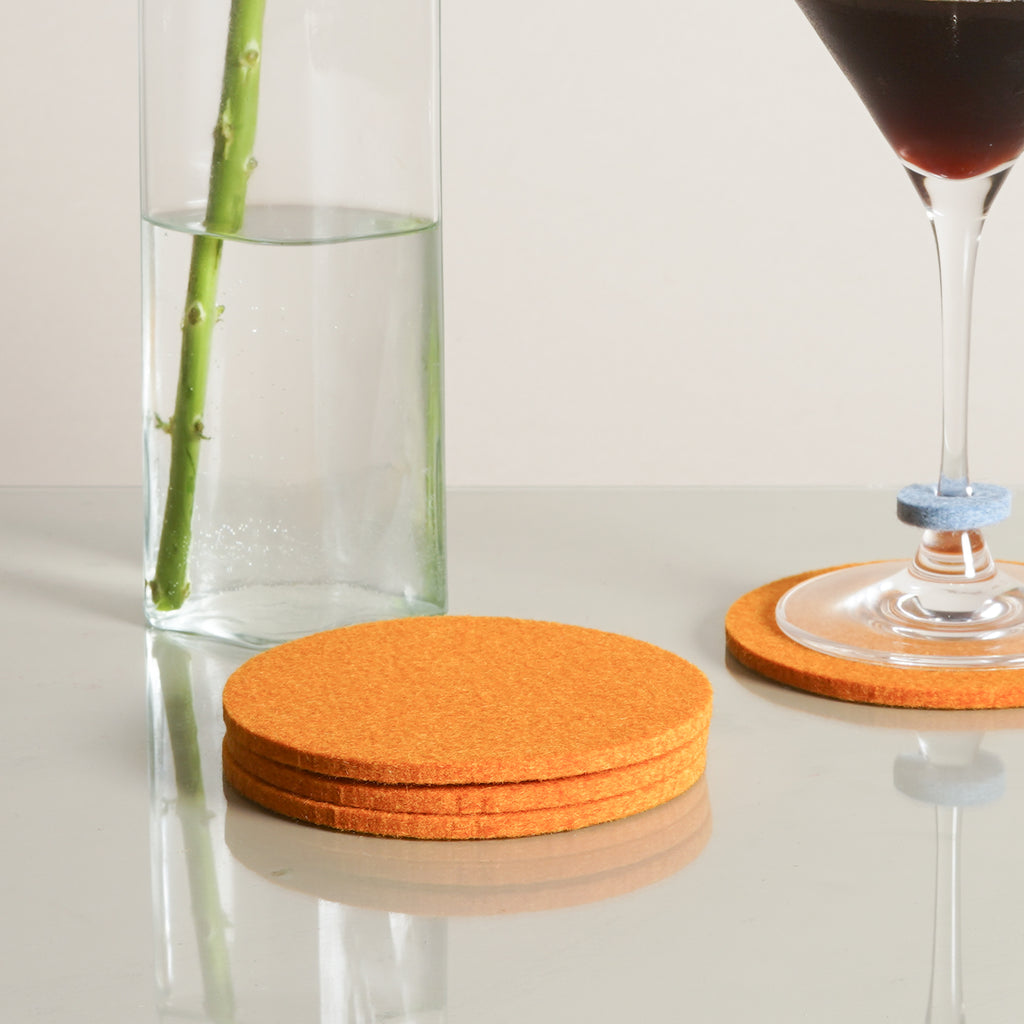 Made from naturally water resistant wool felt, the Bierfilzl Round Felt Coasters in charcoal by Graf Lantz are a fun and useful accessory.