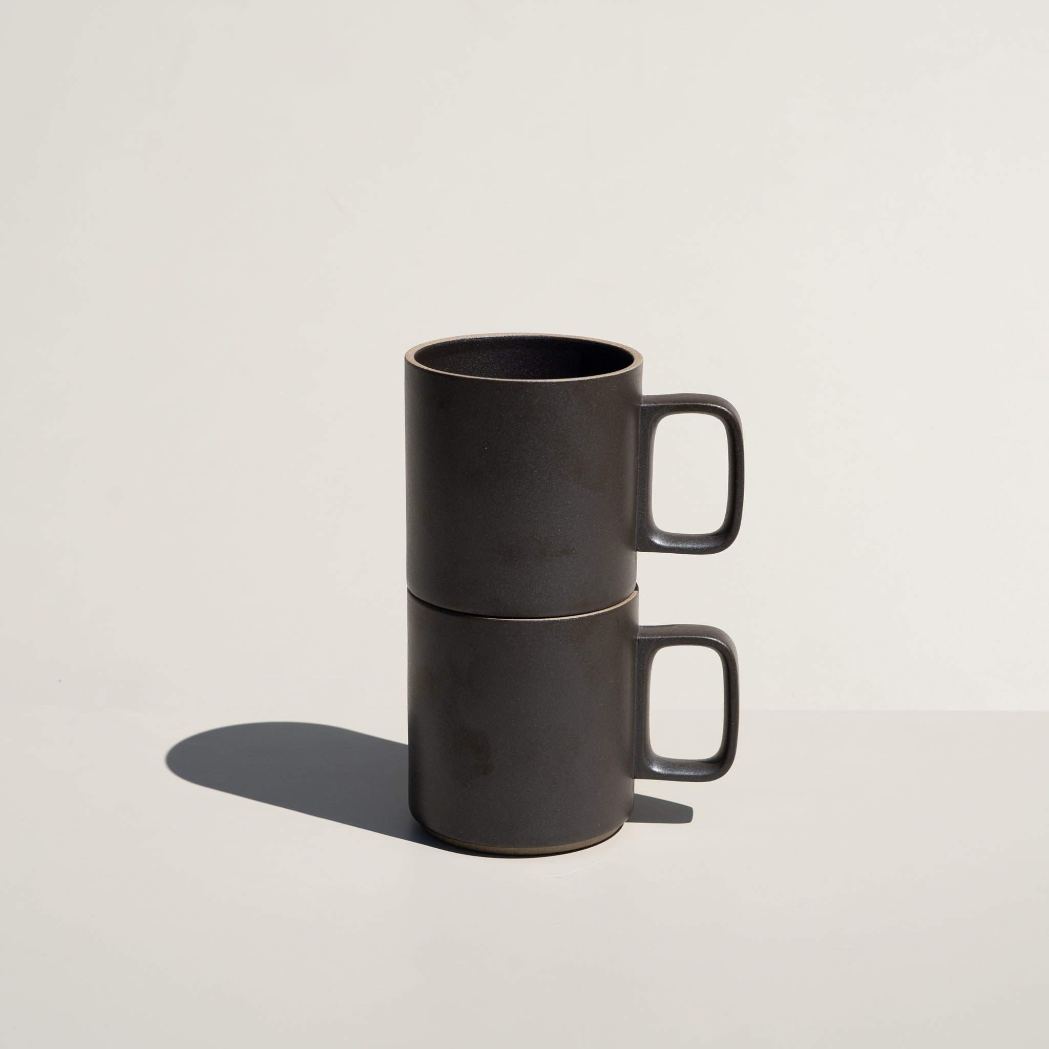 The 13oz Mug in black from Hasami Porcelain has a stackable design.